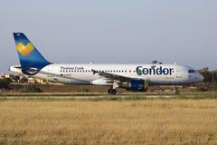 Condor A320 na luz do por do sol Fotografia de Stock
