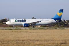 Condor A320 na luz do por do sol Imagens de Stock