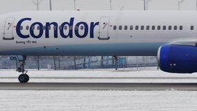 Condor plane taking off from Munich Airport, close-up view after defrosting. Condor Flugdienst jet takes off from Munich Airport, snow on runways stock video footage