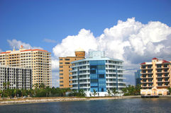 Condos by the Bay. Condos on Sarasota Bay, with masses of white clouds in the background royalty free stock photo