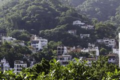 Condos in the mountainous jungle of Puerto Vallarta, Mexico stock photo