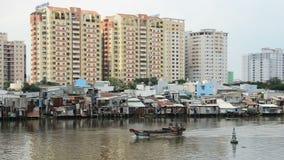 Condos and Shacks on the Saigon River - Ho Chi Minh City (Saigon) stock video footage