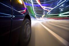 Condução da cidade da noite Imagens de Stock Royalty Free