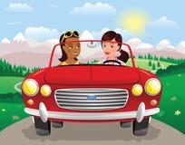 Condução das meninas sportscar nas montanhas Imagem de Stock