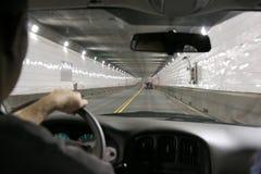 Condução em um túnel foto de stock