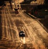 Condução em uma estrada tormentoso na chuva Fotografia de Stock Royalty Free