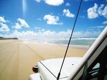 Condução na praia Imagens de Stock