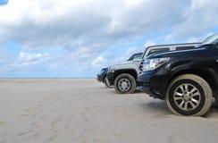 Condução na praia Foto de Stock