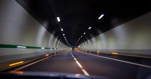 Condução rapidamente em um túnel na estrada fotografia de stock royalty free