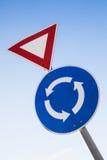 Conduca e traffichi i segni della rotonda Immagine Stock Libera da Diritti