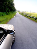 Conducción abajo de carril del país Fotos de archivo