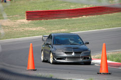 Conducción de automóviles de deportes en curso de raza Imagen de archivo libre de regalías