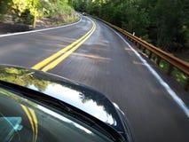 Conducción de automóviles rápidamente Foto de archivo