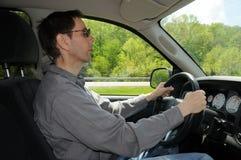 Conducción de un carro Imagen de archivo