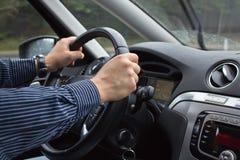 Conducción de una opinión de Car Foto de archivo libre de regalías