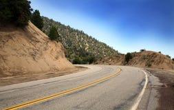 Conducción del camino ventoso Fotografía de archivo