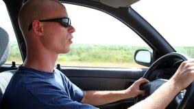 Conducción del coche Imagenes de archivo