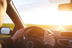 Conducción del coche en el camino vacío Fotos de archivo libres de regalías