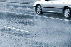 Conducción en lluvia pesada Imágenes de archivo libres de regalías