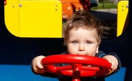 Conducción feliz del niño pequeño Imágenes de archivo libres de regalías