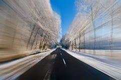 Conducción rápidamente en invierno Foto de archivo libre de regalías