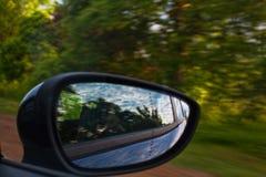 Conducción a través del bosque en coche Imágenes de archivo libres de regalías