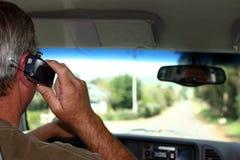 Conducción y el hablar Fotos de archivo libres de regalías