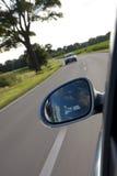 Conducción en una carretera nacional Imagen de archivo libre de regalías