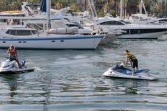 Conduciendo el jet esquíe en el puerto de Alicante Imágenes de archivo libres de regalías
