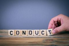 Conduct, wooden letters on the office desk. Informative and communication background Stock Photography