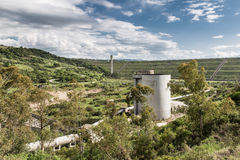 Conducted hydroelectric plant. View of a hydroelectric conducted with silos Stock Photos