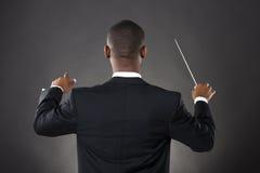 Conducteur dirigeant avec son bâton Photos libres de droits