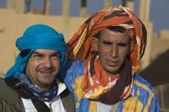 Conducteur et compagnon de chameau Photographie stock libre de droits