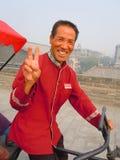 Conducteur heureux de pousse-pousse Photos libres de droits