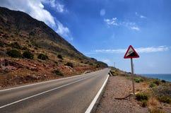 Conducteurs d'avertissement de panneau routier Images stock