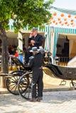 Conducteurs de chariot habillés dans le corto de traje de tradional Photographie stock libre de droits