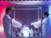 Conducting biohazard experiments in sterile chamber Royalty Free Stock Photography
