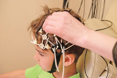 Conducting EEG for a child Stock Photo