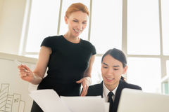 Conducting Negotiations with Asian Business Partner Royalty Free Stock Photo