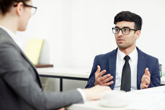 Conducting Negotiations in Boardroom royalty free stock photo