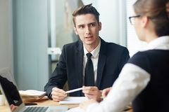 Conducting Negotiations with Business Partner Stock Photos