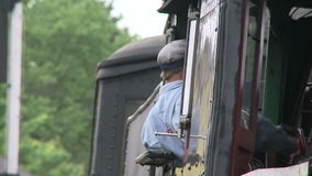 Conductor backing up the train stock footage