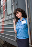 Conductor of the carriage. The beautiful girl a conductor of the carriage Royalty Free Stock Images