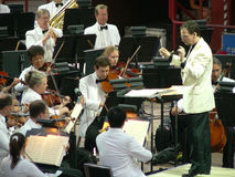 Conductor of the Colorado Symphony Orchestra. Associate Conducter Scott O'Neil conducts the Colorado Symphony Orchestra while perfroming at Red Rocks Royalty Free Stock Photo