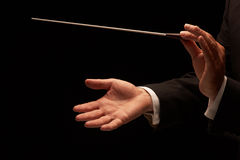 Conductor conducting an orchestra. Isolated on black background royalty free stock photos