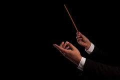 Conductor conducting an orchestra stock photography