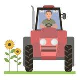 Conductor detrás de la rueda del tractor Fotografía de archivo libre de regalías