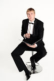 Conductor dreams. Conductor with baton studying music score Royalty Free Stock Photos