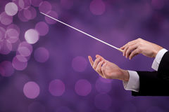 Conductor is leadership. Male orchestra conductor hands with gesture, one with baton. Leadership and manager concepts stock illustration