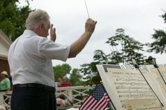 Conductor leading band. For 76 new American citizens at Independence Day Naturalization Ceremony on July 4, 2005 at Thomas Jefferson's home, Monticello Stock Photos